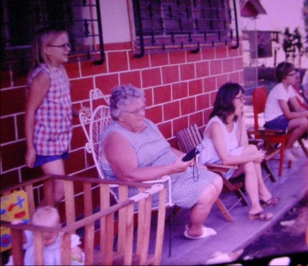 With my Oma, in front of our house, I imagine, I'm in the lower left in my playpen